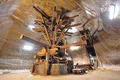 image of salt mine  - old extraction salt machine inside of salt mine
