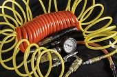 picture of air compressor  - A shot of air hoses and air tools used with an air compressor - JPG