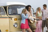 stock photo of campervan  - Group of multiethnic young people with campervan - JPG