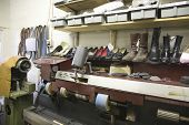 Footwear on shelves at traditional shoemaker workshop