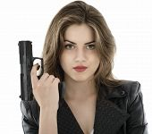 stock photo of laws-of-attraction  - Young beautiful woman holding a gun on white background - JPG