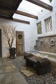 stock photo of hacienda  - View of water feature along tiled and gravel pathway - JPG