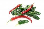 foto of pimiento  - Pimientos with red hot peppers on a light background - JPG