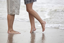 stock photo of wet pants  - couple kissing on the beach - JPG