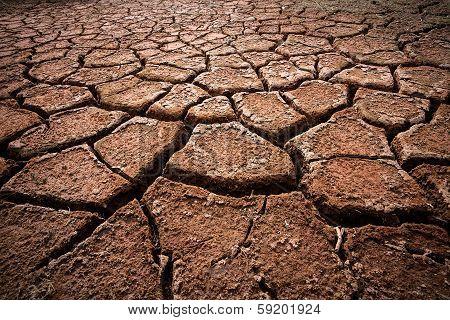 Red Cracked Ground. Deep Cracks