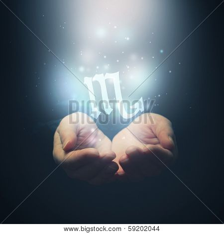 Female Hands Opening To Light And Holding Zodiac Sign For Scorpio