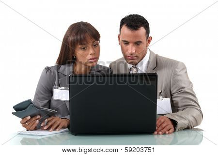 Colleagues searching the Internet