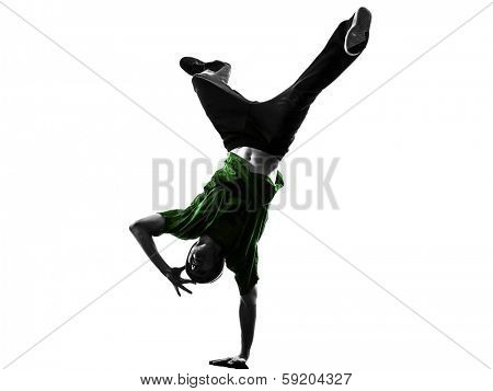 one caucasian young acrobatic break dancer breakdancing man in silhouette  white background