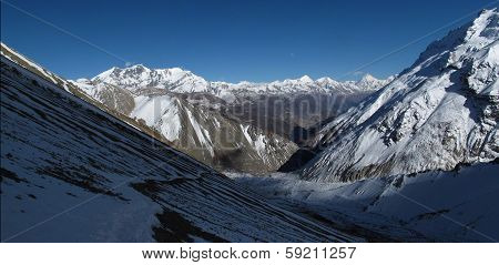Foot path from Tilicho Lake to Tilicho Base Camp and high mountains