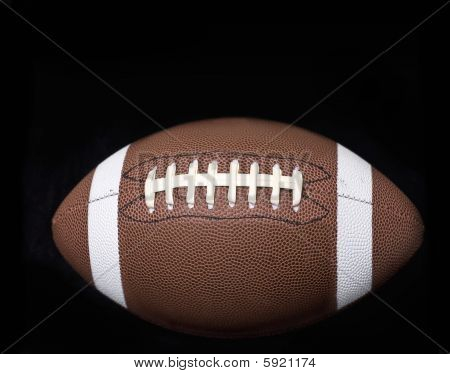 american football object on black background texture surface
