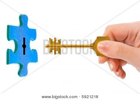 Hand With Key And Puzzle