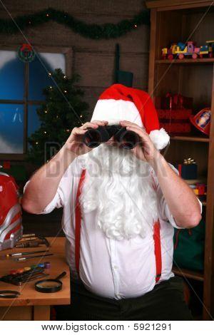 Santa looks though his binoculars