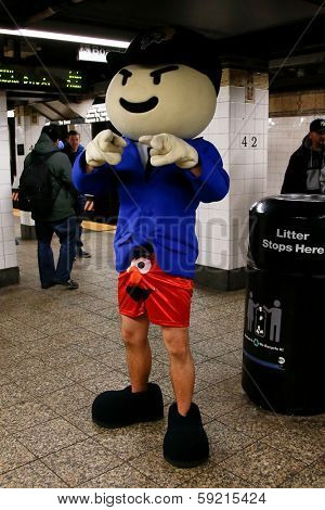 NEW YORK-JAN 12: A participant in the 13th annual international 'No Pants Subway Ride' waits for the uptown 6 train at Bleecker Street on January 12, 2014 in New York City.