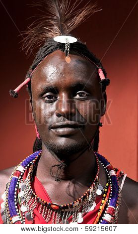 MAASAI MARA, KENYA - AUGUST 10: Maasai man in the village on August 10, 2010. The Maasai are the most famous tribe in Africa. They are nomadic and live in small villages.