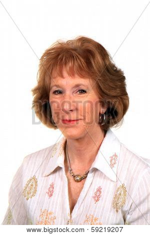 A beautiful mature Caucasian woman smiles for the camera during her fashion photo shoot. The perfect shot for all your Beautiful Mature Female needs. isolated on white with room for your text