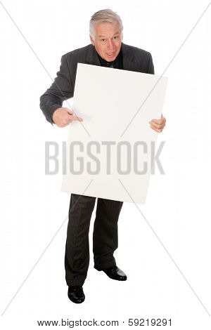 A Handsome Middle Aged Business Man points to and holds a white sign with room for your text or image. The perfect Sign Holding image for all your advertising needs. Images and text easily replaceable
