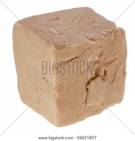 baking ingredient yeast cube isolated on white background