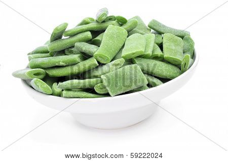a bowl with frozen chopped green beans on a white background