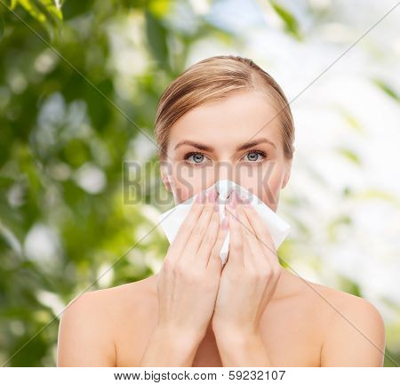 cosmetics, health and beauty concept - beautiful woman with paper tissue