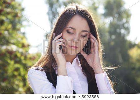 Serious woman call phone