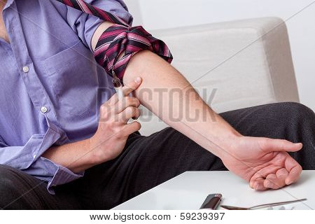 Addict Preparing Arm For Injection