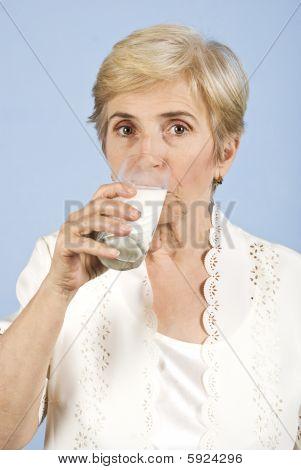 Woman Aged Drinking Milk