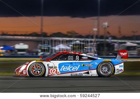 Daytona Beach, FL - Jan 25, 2014:  The Telcel Ford EcoBoost travels through the turns during Rolex 24 at Daytona at Daytona International Speedway in Daytona Beach, FL.