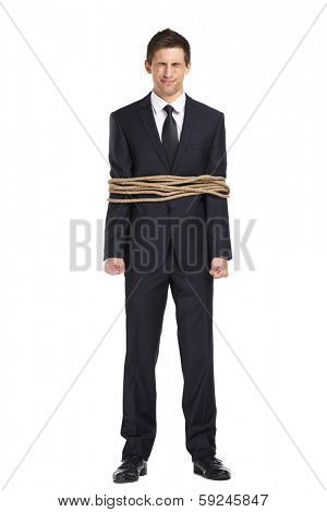 Full-length portrait of businessman tied with the rope, isolated on white. Concept of slavery and violence