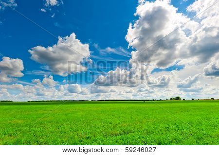 Beautiful Clouds Over The Lush Green Grass