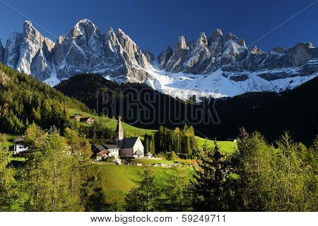 Santa Maddalena village in front of the Geisler or Odle Dolomites Group, Val di Funes, Italy, Europe.