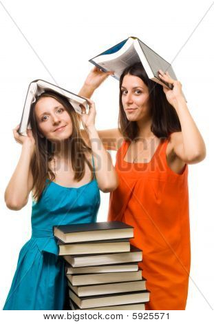 Two Young Student Woman Play With Books