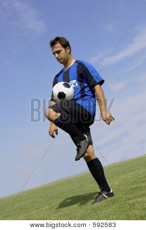 Football - Soccer Player Juggling