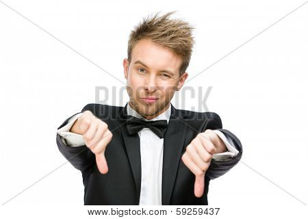 Half-length portrait of business man thumbing down, isolated on white