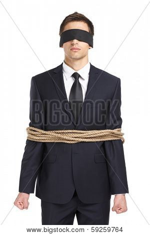 Portrait of  blind-folded businessman tied with the line, isolated on white. Concept of slavery and violence