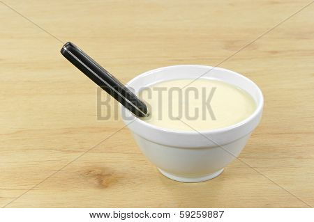 Cheese Soup In Bowl With Spoon