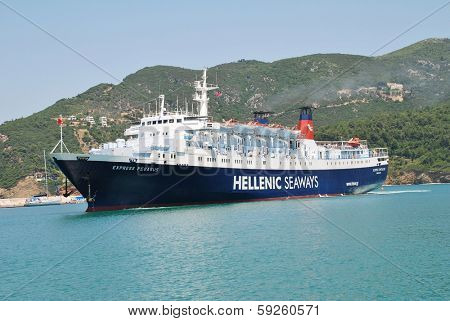 SKOPELOS, GREECE - JUNE 24, 2013: Hellenic Seaways ferry Express Pegasus arrives at Skopelos Town harbour on the Greek island of Skopelos. The ship was built in Italy in 1977.