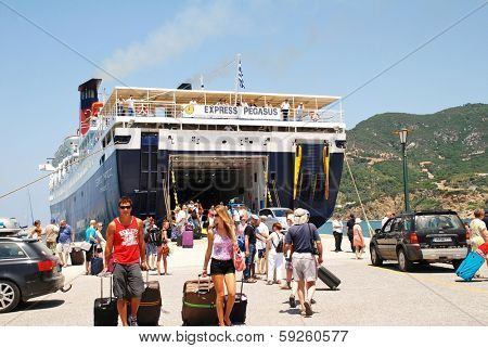 SKOPELOS, GREECE - JUNE 24, 2013: Hellenic Seaways ferry Express Pegasus disembarks passengers at Skopelos Town on the Greek island of Skopelos. The island was the location for the film Mamma Mia!