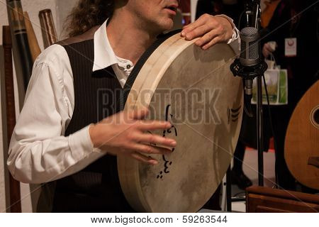 Detail Of A Musician Playing Pecussion Instrument At Olis Festival In Milan, Italy