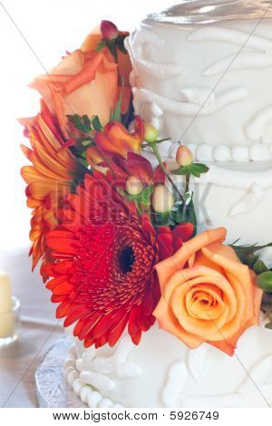 Closeup Of White Wedding Cake With Colorful Flowers