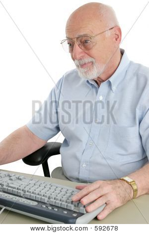 Senior Man Browses Internet