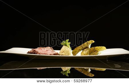 Slices of meat with marinated cucumbers