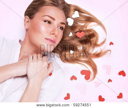 Young lady in love, closeup fashionable portrait, lying down, beautiful glossy hair, many little hearts decor, Valentine day concept