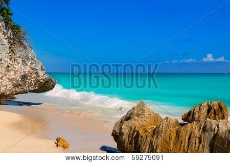 Tulum beach near Cancun turquoise Caribbean water and blue Sky