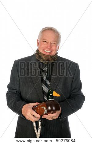 A handsome and obviously well educated business man tries to hold a serious conversation but runs afoul while on a Duck Decoy Telephone. Isolated on white with room for your text.