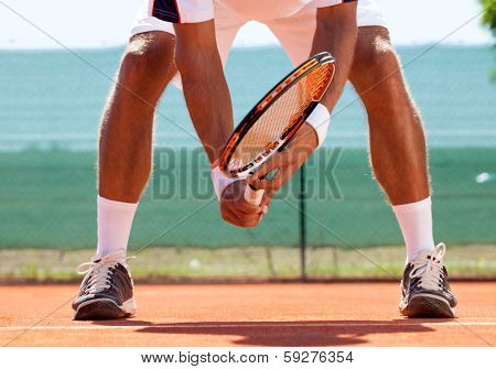 tennis court from low angle with Tennis player in action.
