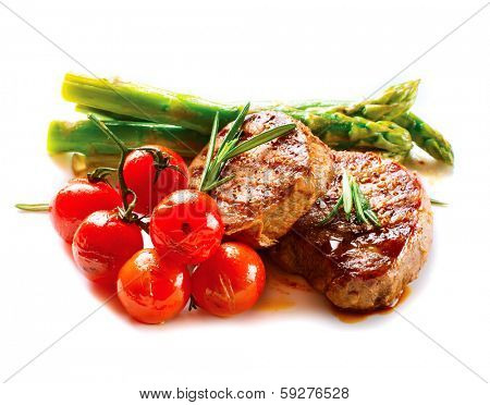 BBQ Steak. Barbecue Grilled Beef Steak Meat with Vegetables. Healthy Food. Barbeque Steak Dinner isolated on a white background