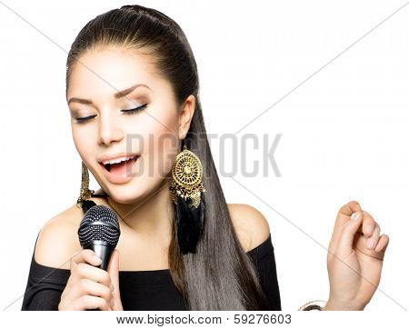 Singing Woman. Beautiful Singing Girl. Beauty Woman with Microphone over White Background. Singer. Karaoke song