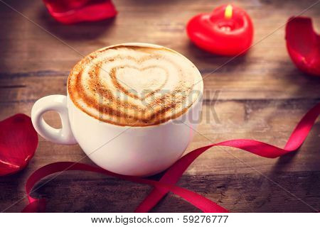 Valentine's Day Coffee with heart on foam. Heart drawing on latte art coffee. Love concept