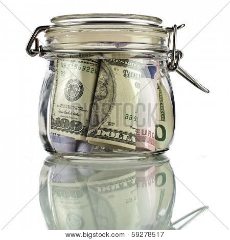 Money glass jar full of savings isolated on white background