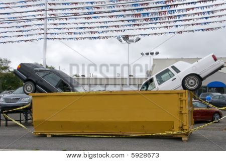 Cars In A Dumpster